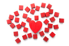 Love in All Shapes. Concept photo for love fits all shapes showing heart and red blocks on white background Stock Photography