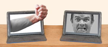 Online internet abuse rage computer tablet device stock image