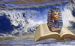 Bible prophecy pharaoh at red sea crossing. Concept photo of open holy bible with mask of pharaoh at the red sea crossing stock photography