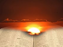Bible spiritual light for mankind. Concept photo of open holy bible with sun rising through storm clouds depicting spiritual light for mankind royalty free stock image