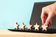 Concept photo of setting a five star goal. increase rating or ranking, evaluation and classification idea. Concept photo of setting a five star goal. increase stock photos