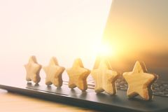 Concept photo of setting a five star goal. increase rating or ranking, evaluation and classification idea. Concept photo of setting a five star goal. increase royalty free stock photography