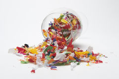 The Party is Over. Concept photo showing wine glass with confetti spilling out to indicate the party is over stock photo