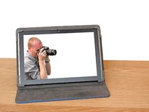Taking photos for stock photography on dreamstime. Concept photo of stock photograph for dreamstime website showing man with camera looking for shots to add to royalty free stock photo