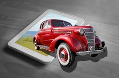 Out of frame vintage classic chevrolet car computer tablet device. Concept photo of vintage classic american chevrolet driving out of tablet computer device stock images