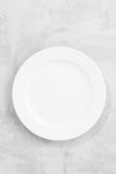 Concept photo, white empty plate, top view, vertical Stock Photos