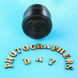 The concept of the photographer's day and the day of photography on a blue pastel background. The concept of the photographer's day and the day of photography royalty free stock image
