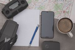 Notepad, drone, smartphone and cup of coffee for plan your drone flight royalty free stock image