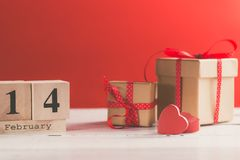 Concept photography of Valentine`s gift. With wooden calendar shows the date 14 february stock images