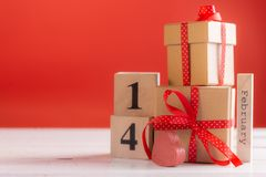 Concept photography of Valentine`s gift. With wooden calendar shows the date 14 february royalty free stock image