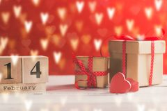 Concept photography of Valentine`s gift. With wooden calendar shows the date 14 february royalty free stock photography