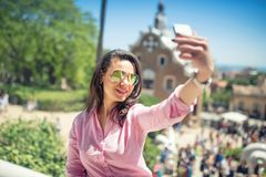 Concept of photography, young woman taking selfie with mobile phone Royalty Free Stock Photos
