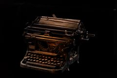 Concept shot of antique manual typewriter with paper on black background, selective focus. Concept picture of antique manual typewriter with vintage paper on Royalty Free Stock Photography