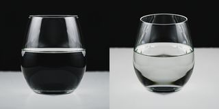 Concept picture of a glass half filled with water stock photo