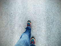 Concept picture of legs walking on asphalt Royalty Free Stock Photos