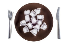 Concept picture of a plate with ice cubes Stock Photos