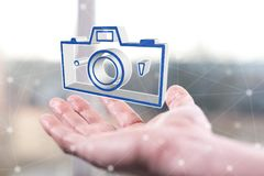 Concept of pictures sharing. Pictures sharing concept above a hand of a man Royalty Free Stock Images