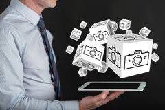 Concept of pictures sharing. Pictures sharing concept above a tablet held by a man Royalty Free Stock Photo