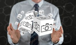 Concept of pictures sharing. Pictures sharing concept between hands of a man in background Stock Image
