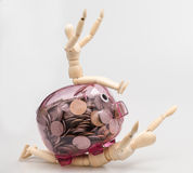 concept through piggy bank pink with money coins on man Wood royalty free stock image