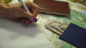 Concept planning vacations. Girl makes notes in a Notepad. Concept planning vacations stock video footage