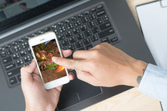 The concept of playing games on mobile phones: adult men. Create Stock Image