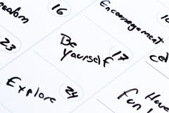 Concept for a positive month. Dry erase calendar with different positive messages on every different day as a concept for a positive good month Royalty Free Stock Image
