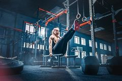 Concept: power, strength, healthy lifestyle, sport. Powerful attractive muscular woman at CrossFit gym royalty free stock photography