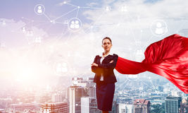 Concept of power and sucess with businesswoman superhero in big city Stock Photos