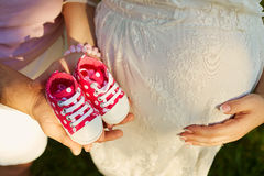 The concept of pregnancy and childbirth. Close-up, top view of t Stock Images