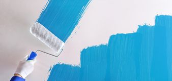 Concept of professional hand painting blue sample on wall royalty free stock photos