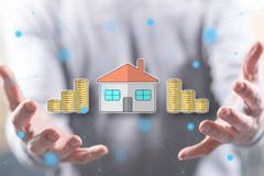 Concept of property investment. Property investment concept above the hands of a man in background stock photo