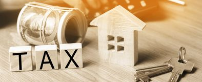 Concept of property taxes, purchase and sale of property and house. inscription 'tax'. Declaration of the income of a physical pe. Concept of property taxes royalty free stock photos