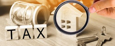 Concept of property taxes, purchase and sale of property and house. inscription `tax`. Declaration of the income of a physical per stock photos