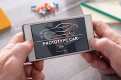 Concept of prototype car. Prototype car concept on mobile phone Royalty Free Stock Image