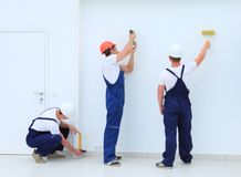 Team of builders finishers work indoors Royalty Free Stock Photography