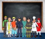 Concept rêveur de professions de diversité des travaux d'enfants d'enfants Photographie stock