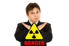 Сoncept-radiationdanger! Man with crossed arms Stock Photo