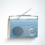 Concept of a radio. Retro transistor radio  on shiny sky blue background Royalty Free Stock Images