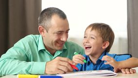 The concept of raising children, children`s time. Emotions of happiness, joy and love. Father and son together draw on stock footage