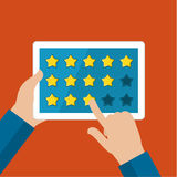 Concept of rating. Hands holding a tablet computer with rating system and hand pushing the button. Flat design vector illustration Royalty Free Stock Images