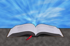 Concept of rays from heaven shining down on a Christian bible Royalty Free Stock Photography