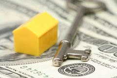 Concept of real estate. House, key and dollar, concept of real estate Royalty Free Stock Photo