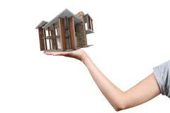 Concept of real estate business: house on the hand Royalty Free Stock Photography