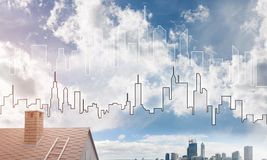 Concept of real estate and construction with drawn silhouette on big city background Stock Photos