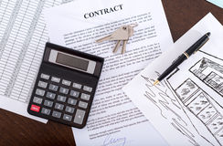 Concept of a real estate contract. Real estate contract with keys, calculator and pen (random english dummy text used Royalty Free Stock Images