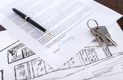 Concept of a real estate contract. Real estate contract with keys and pen (random english dummy text used Royalty Free Stock Image