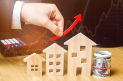 The concept of real estate market growth. The increase in housing prices. Rising prices for utilities. Increased interest in. Mortgage and rising interest rates stock image