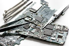 Concept repair smartphone - parts of digital gadgets with tools Stock Image
