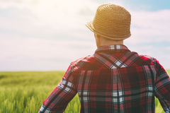 Concept of responsible farming, female farmer in cereal crops fi Stock Photo